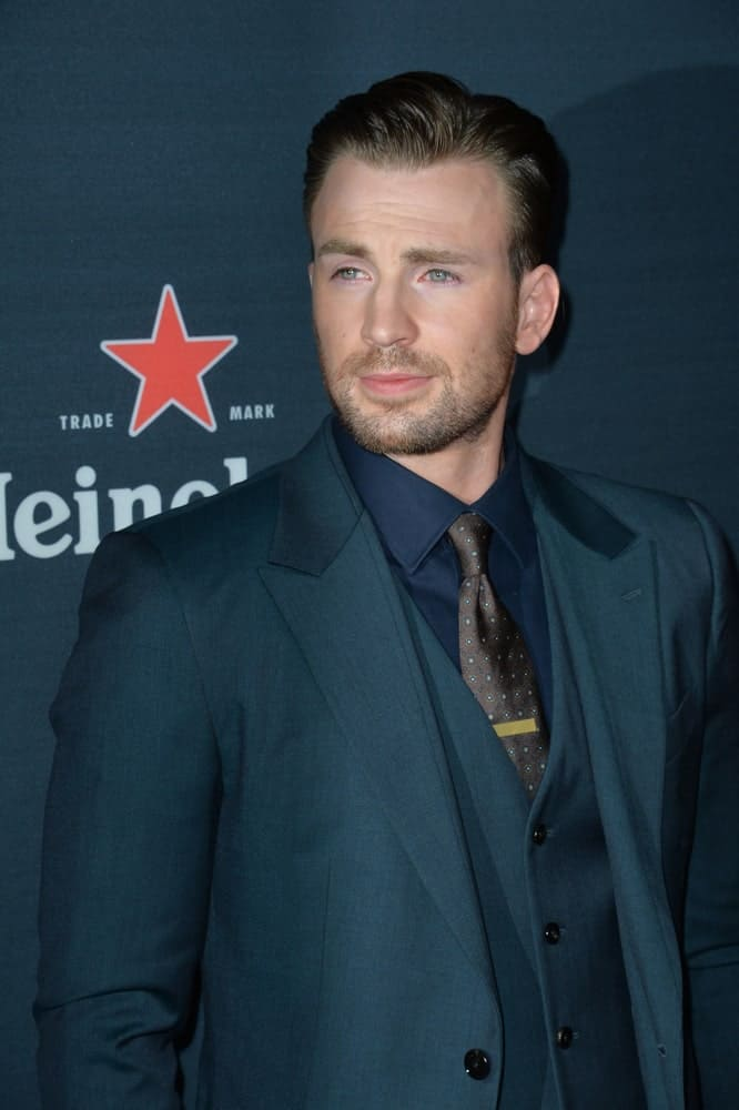 On September 2, 2015, Chris Evans's gorgeous eyes sparkled with his brushed back undercut hairstyle with a slick finish at the Los Angeles premiere of his movie