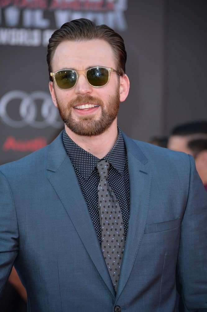On April 12, 2016, Actor Chris Evans looked absolutely cool with his sunglasses, charcoal suit and slick pompadour hairstyle at the world premiere of