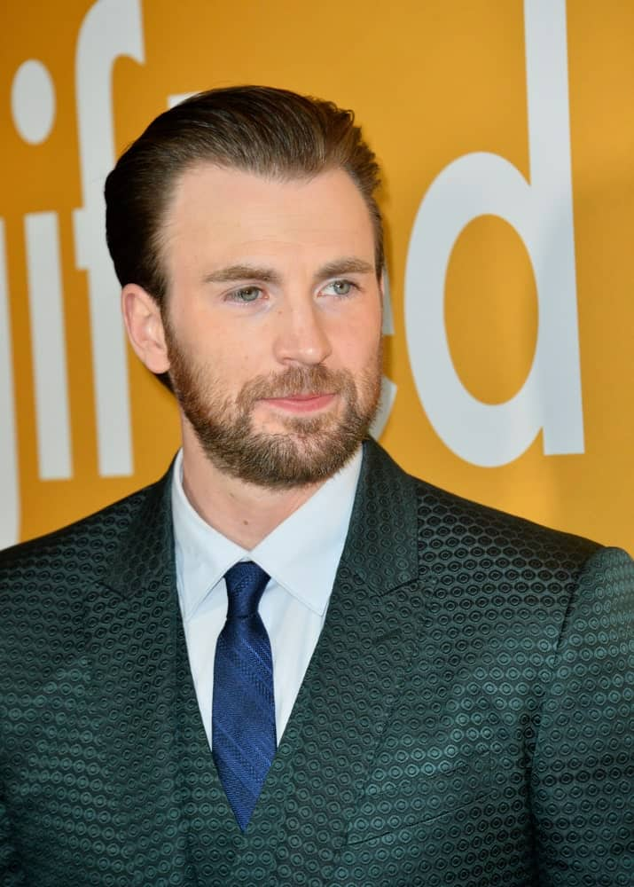 On April 4, 2017, Actor Chris Evans wore a beautiful patterned three piece suit that he paired with his slicked back hairstyle at the premiere for