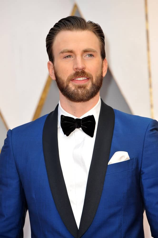 Chris Evans sported a side-parted slick pompadour look to go with his classy blue tux at the 89th Annual Academy Awards held at the Hollywood and Highland Center in Hollywood on February 26, 2017.