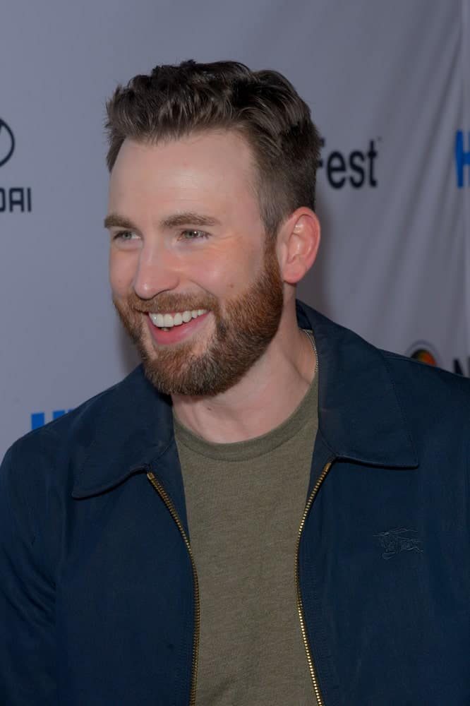 "Chris Evans flashed his bright smile with his casual outfit and side-parted fade hairstyle at the opening night screening of ""Sell By"" during NewFest Film Festival at SVA Theater on October 23, 2019 in New York City."