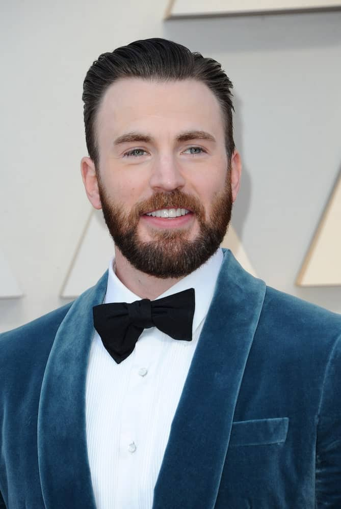 Chris Evans wore a blue velvet suit with his vintage slicked back hairstyle at the 91st Annual Academy Awards held at the Hollywood and Highland in Los Angeles on February 24, 2019.