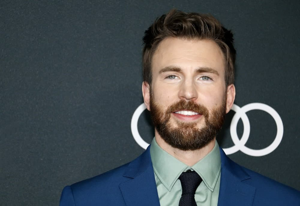Chris Evans was at the World premiere of 'Avengers: Endgame' held at the LA Convention Center in Los Angeles on April 22, 2019. He wore a classy blue suit with his full beard and brushed up fade pompadour hairstyle.