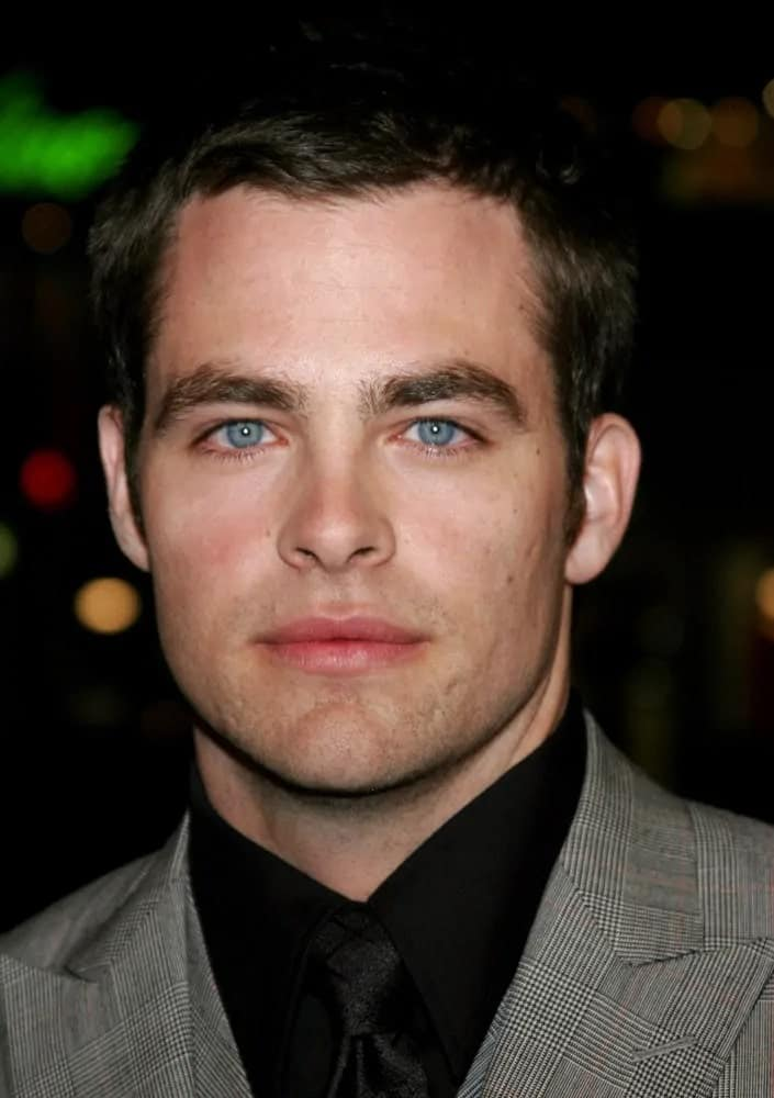 "The talented actor, Chris Pine, wore a fashionable patterned gray suit and dyed his short crew cut hair black when he attended the 2007 world premiere of ""Smokin' Aces"" in Hollywood, CA."