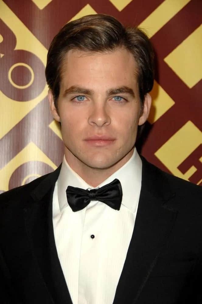 Chris Pine's handsome features are at full display with this neat and short side-parted slick hairstyle and classy black tux during the 2009 HBO Golden Globe Awards After Party in Beverly Hills, CA.