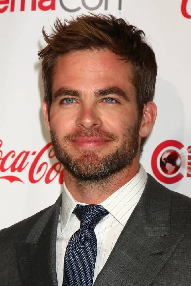 Chris Pine paired his bearded look with short tousled hair featuring some side-swept spikes during the CinemaCon Big Screen Achievement Awards at Las Vegas in 2013.