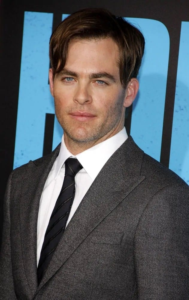 "Chris Pine wore a dark brown undercut hairstyle with long side-swept bangs and five o'clock shadow to pair his classy gray suit at the Los Angeles 2014 premiere of ""Horrible Bosses 2""."