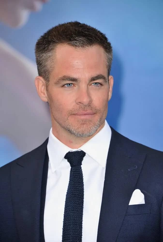 Chris Pine's brilliant blue eyes are at full display with his short salt and pepper crew cut and trimmed beard at the Los Angeles 2017 premiere of 'Wonder Woman' held at the Pantages Theatre in Hollywood.