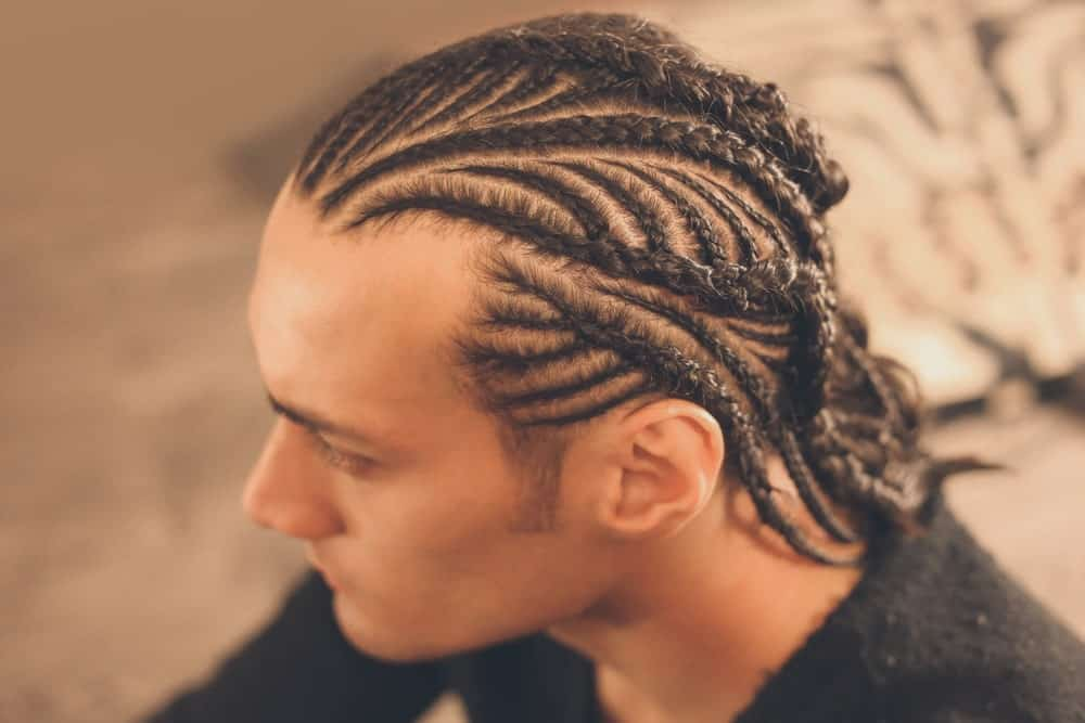Cornrows are very popular among young men. It originates from the African culture and became very popular after NBA legend Allen Iverson wore the hairstyle on the court.