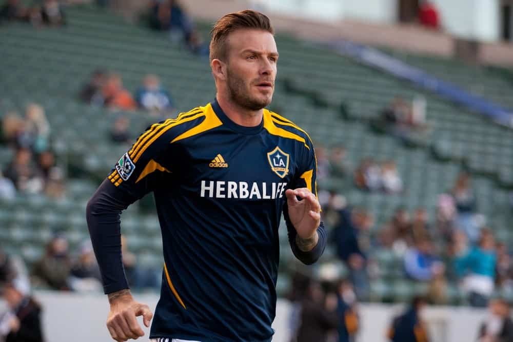 David Beckham warming up before the MLS game between the Los Angeles Galaxy and the Portland Timbers on April 14, 2012. He cut his hair with a neat undercut and styled it with a front brushed up.