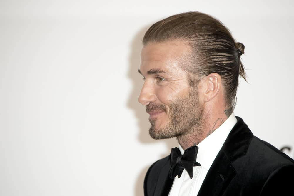 David Beckham shows the side profile of his man bun during the amfAR Gala Cannes 2017 at Hotel du Cap-Eden-Roc on May 25, 2017 in Cap d'Antibes, France.