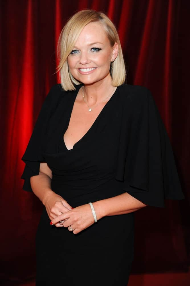 Emma Bunton looking classy with her short bob cut incorporated with long side bangs. This photo was taken on April 28th for the British Soap Awards 2012.