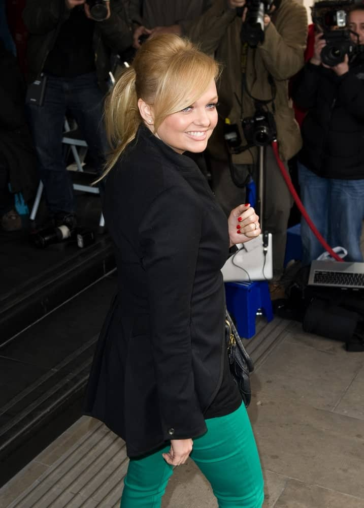 On March 13, Emma Bunton attended the TRIC Awards 2012 at the Grosvenor House Hotel with a high ponytail styled with a classic bouffant and side bangs.