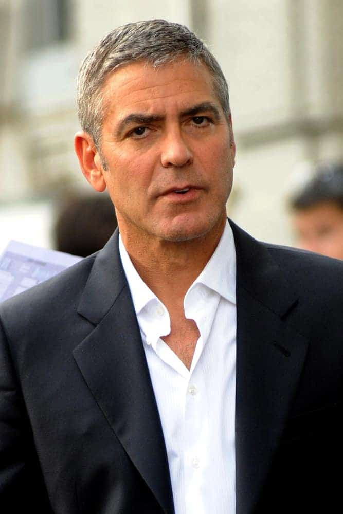 On January 22, 2018, actor George Clooney was seen in Milan, Italy. He wore a smart casual suit with his short and gray Caesar cut hairstyle.