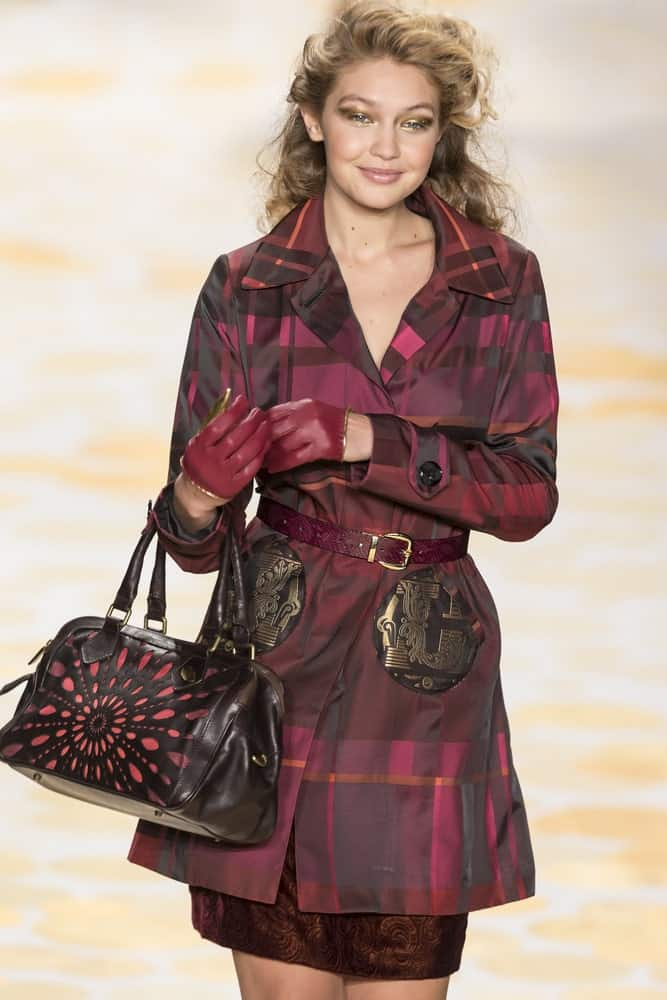 On February 6, 2014, Gigi Hadid walked the runway during the Desigual fall 2014 fashion show at New York Mercedes - Benz Fashion Week. Her hair was styled into a long curly half up hairstyle tousled to perfection.