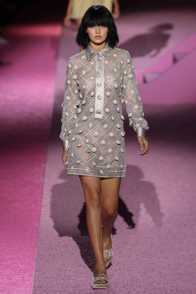 Model Gigi Hadid walked the runway at Marc Jacobs during Mercedes-Benz Fashion Week Spring 2015 at Seventh Regiment Armory on September 11, 2014. Her hair was styled into a raven short bob hairstyle with blunt bangs.