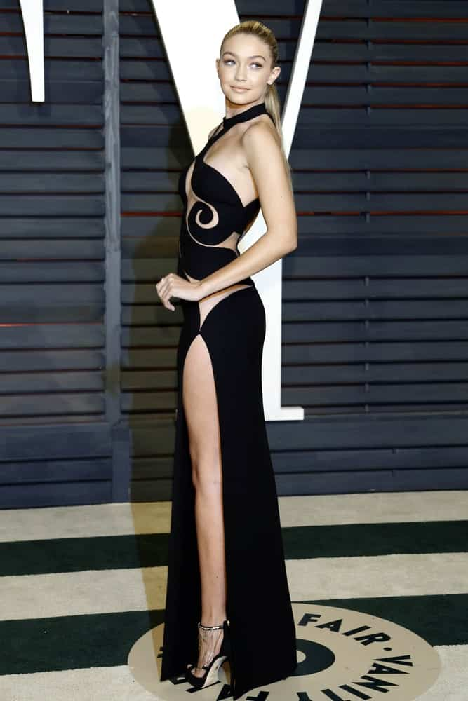 Gigi Hadid was quite classy in her long black dress and slick low ponytail hairstyle at the Vanity Fair Oscar Party 2015 at the Wallis Annenberg Center for the Performing Arts on February 22, 2015 in Beverly Hills, CA.