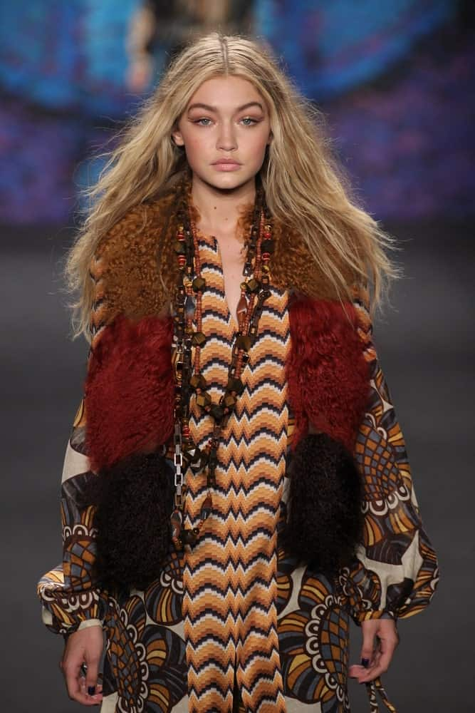 Model Gigi Hadid's mesmerizing eyes were on full display with her long tousled sandy blond hair when she walked the runway at the Anna Sui fashion show during MBFW Fall 2015 at Lincoln Center on February 18, 2015.