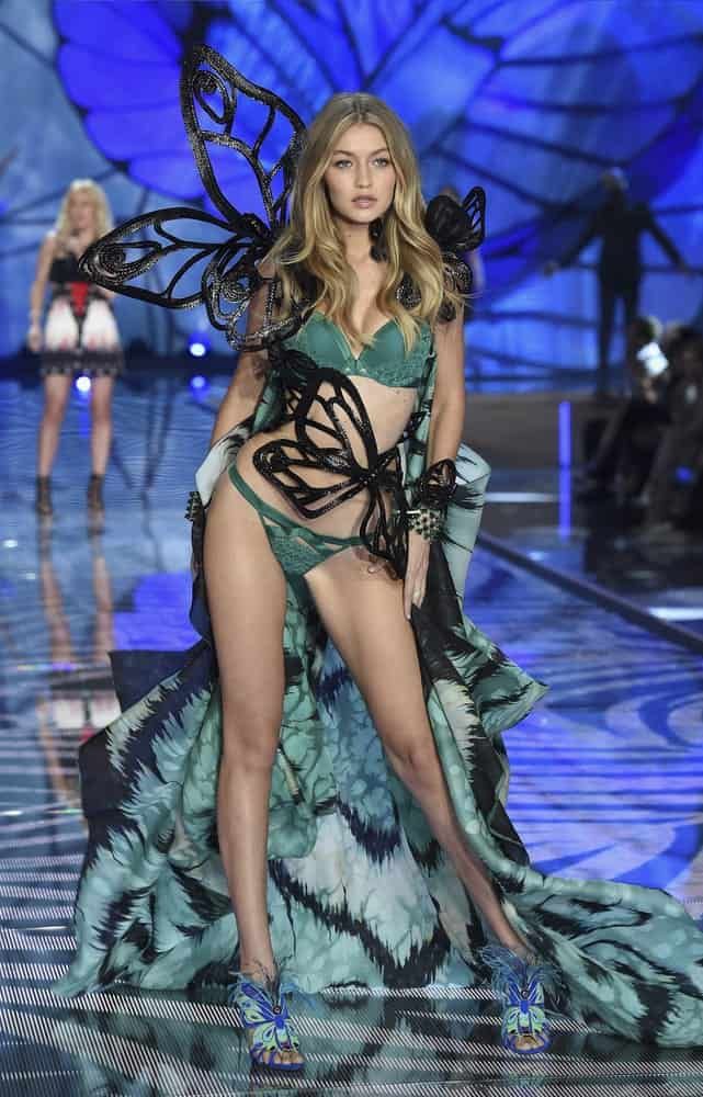 Model Gigi Hadid was dressed in a green outfit with her wavy highlighted hair when she walked the runway during the 2015 Victoria's Secret Fashion Show on November 10, 2015 in New York City.