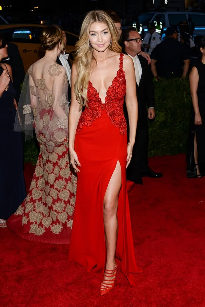 Gigi Hadid attended the Costume Institute Gala held at the Metropolitan Museum of Art in New York City on May 4, 2015. She came in a beautiful red dress that paired well with her long layered wavy hairstyle with highlights.
