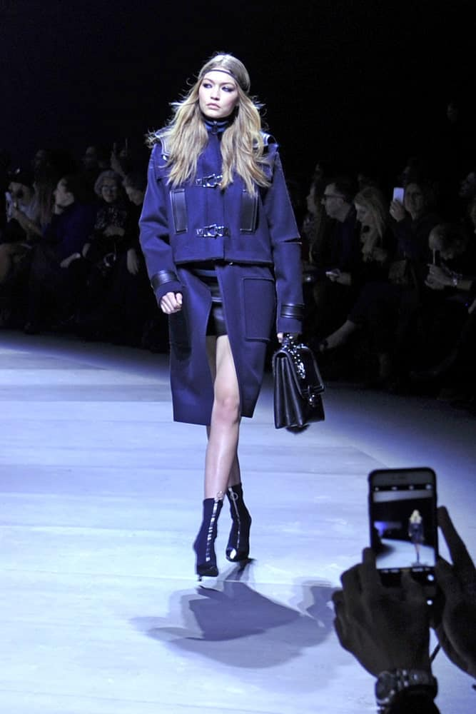 Supermodel Gigi Hadid walked the runway with a long and wavy tousled hairstyle on June 2016 at the Milan Woman Fashion Week for Versace in Italy.
