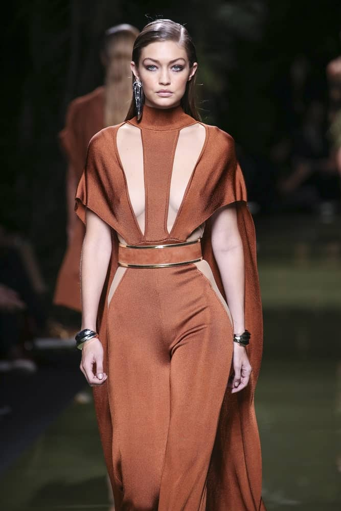 Gigi Hadid's fierce eyebrows were emphasized by her slick side-parted hairstyle when she walked the runway during the Balmain show as part of the Paris Fashion Week Spring/Summer 2017 on September 29, 2016 in Paris, France.