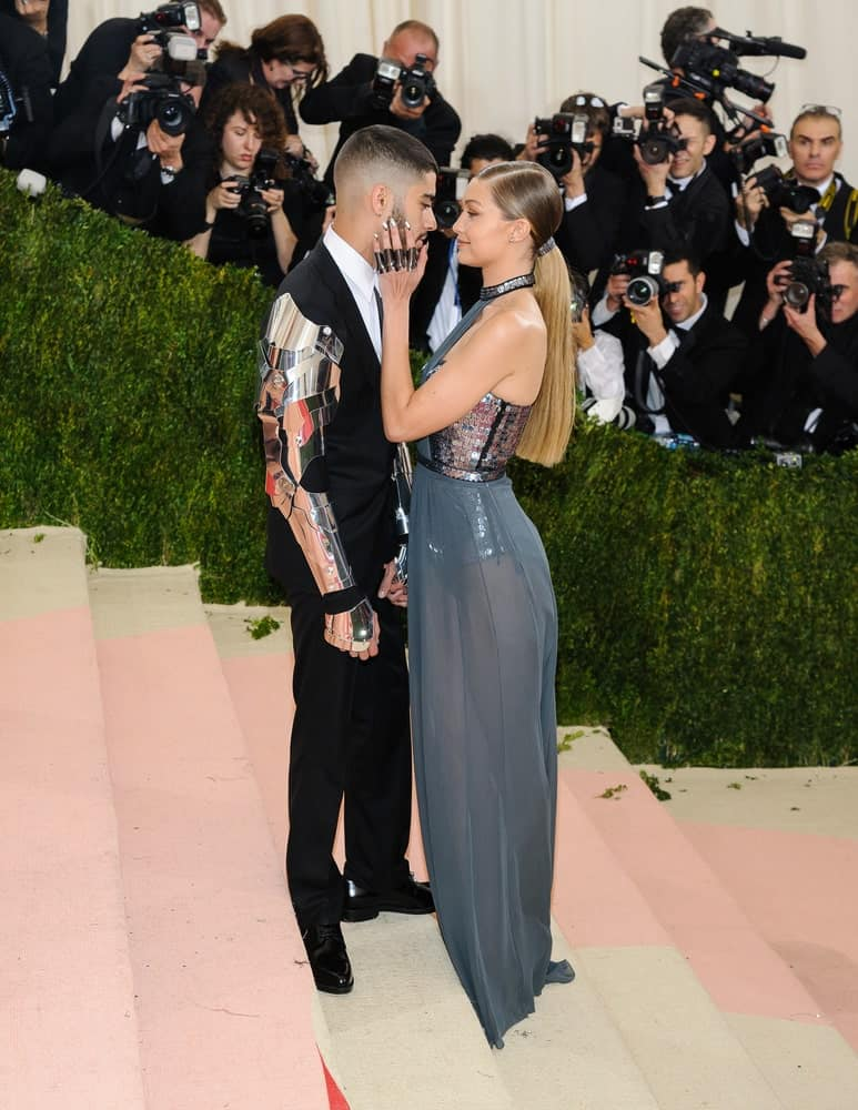Zayn Malik and Gigi Hadid wore matching outfits at the Metropolitan Museum of Art Costume Institute Gala, Manus x Machina: Fashion in the Age of Technology on May 2, 2016. Hadid paired this with a neat highlighted low ponytail.