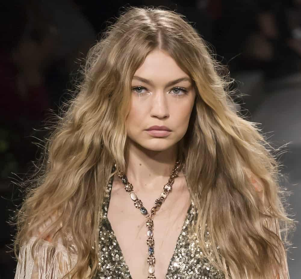 On September 11, 2017, Gigi Hadid walked the runway at the Anna Sui Spring Summer 2018 fashion show during New York Fashion Week. She was dressed in a sequined piece and her hair was loose, tousled and wavy.