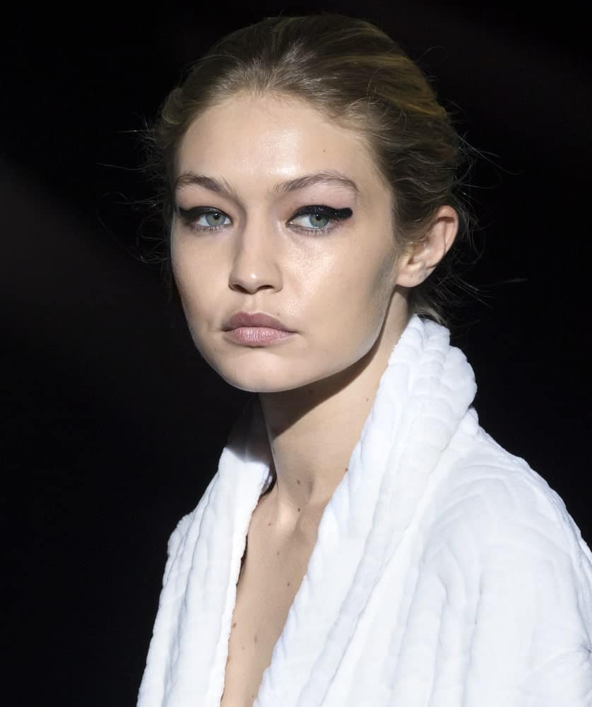 On September 06, 2017, Gigi Hadid walked the runway during rehearsal for the Tom Ford Spring Summer 2018 fashion show in New York. She was still wearing her bathrobe with her hair in a highlighted messy bun hairstyle.