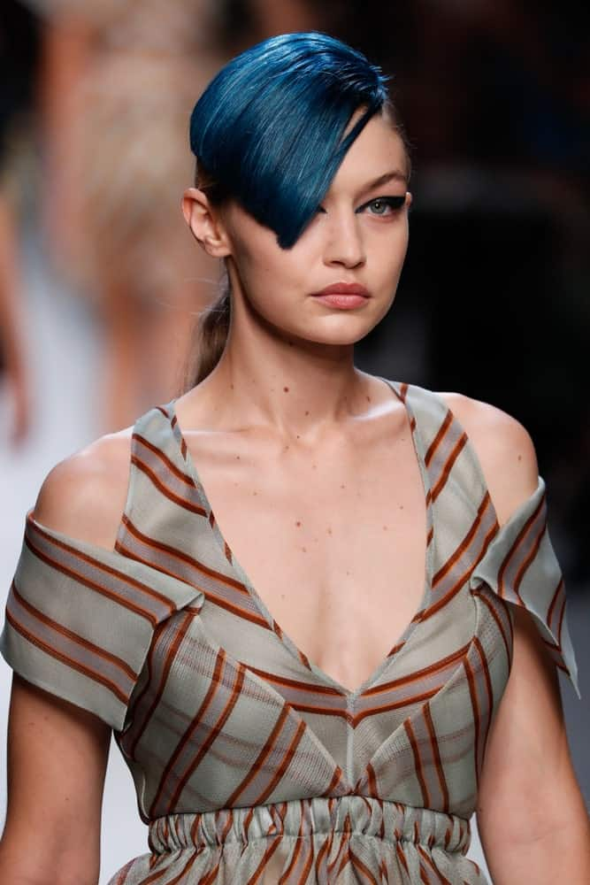 Gigi Hadid's lovely gray dress was paired with a ponytail that has blue-dyed side-swept bangs at the runway for the Fendi show during Milan Fashion Week Spring/Summer 2018 on September 21, 2017 in Milan, Italy.
