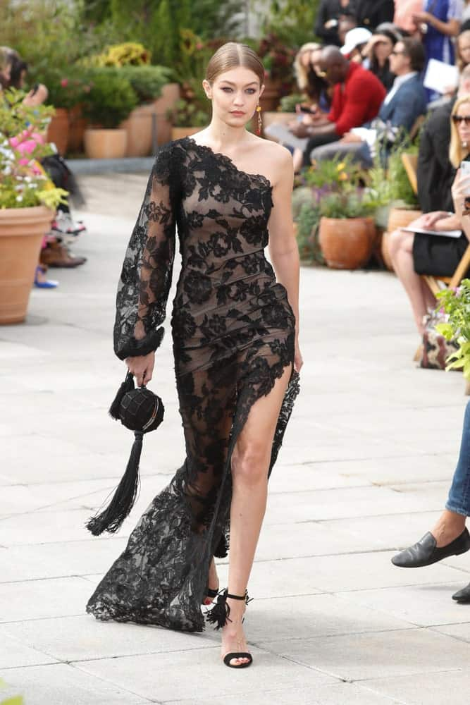 Gigi Hadid looked like a goddess with her sheer black dress and slick bun hairstyle when she walked the runway for Oscar De La Renta during New York Fashion Week: The Shows at Spring Studios Terrace on September 11, 2018 in New York City.