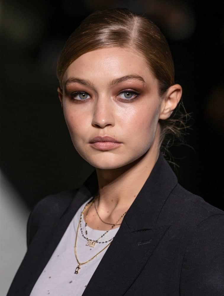 Gigi Hadid walked the runway during rehearsal for the Tom Ford 2019 Spring Summer fashion show during New York Fashion Week on September 5, 2018. Her hair was styled into a neat and slick low bun hairstyle.
