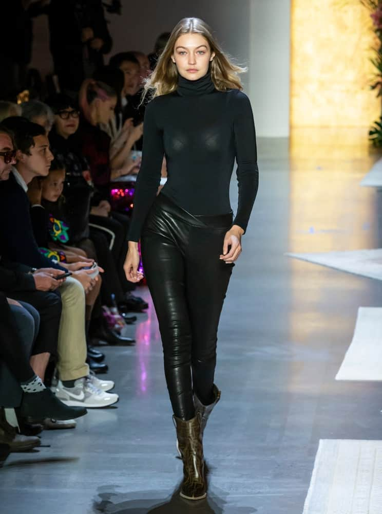 Gigi Hadid's sexy black outfit was a perfect fit for her curves and loose tousled hairstyle at the runway during rehearsal for the Anna Sui Spring Summer 2019 fashion show on September 10, 2018.