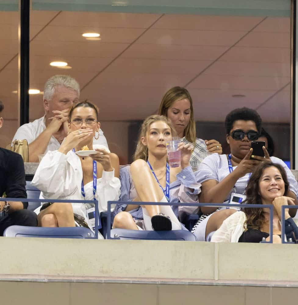 Bella Hadid and Gigi Hadid kicked back and relax at the US Open 2018 quarterfinal match at USTA Tennis Center. Gigi Hadid was seen with a loose button-down shirt and hair was in a loose and tousled ponytail.