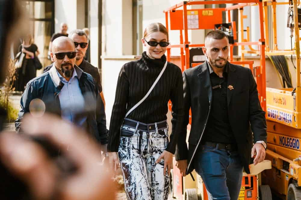 Gigi Hadid was seen before the Max Mara fashion show at Milan Fashion Week on September 20, 2018. She wore a casual long black sweater with her hair in a low bun hairstyle with a slick finish.