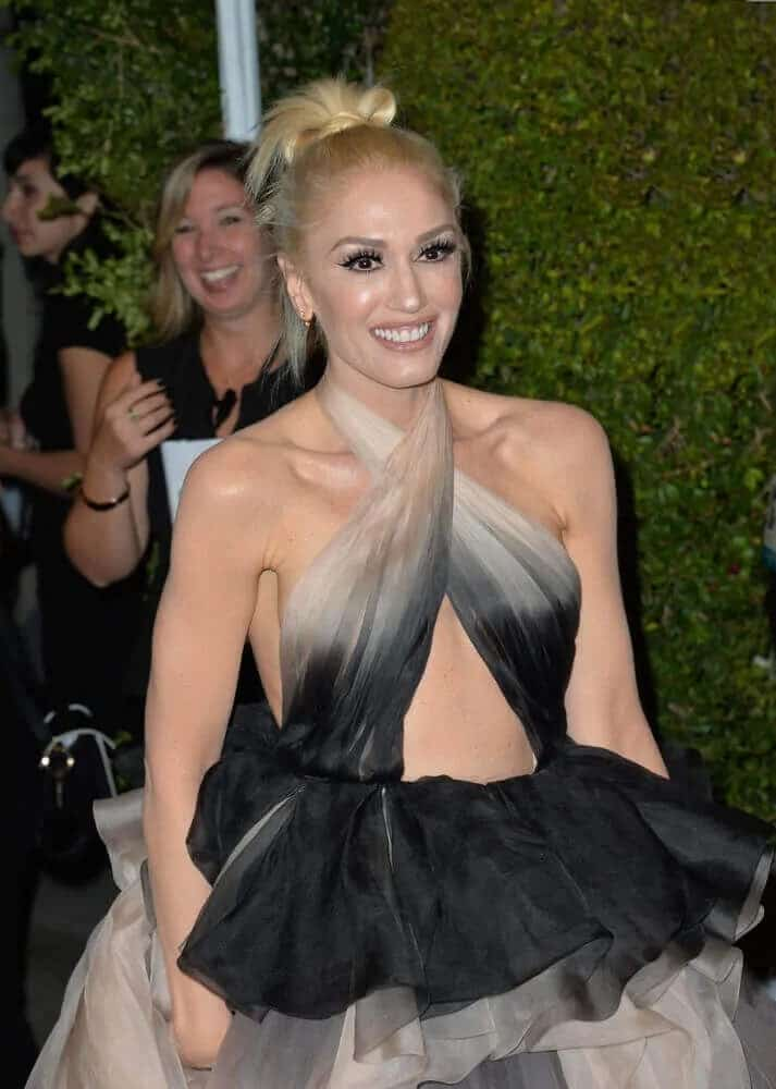 Gwen Stefani paired her stylish and sexy gown with a simple and messy top knot to her sandy blond hair during the Glamour Women Of The Year 2016, November 14, 2016 in Los Angeles, CA.