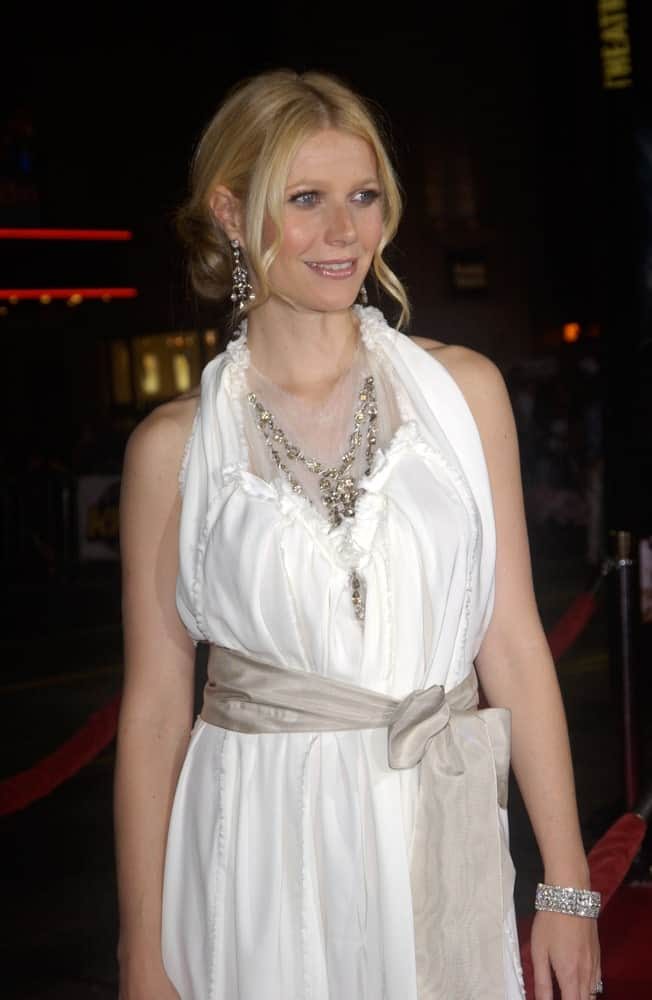 The actress looked gorgeous in a classic low bun with curly tendrils paired with a white halter dress and sparkling accessories. This was taken at the world premiere of her new movie Sky Captain and the World of Tomorrow on September 14, 2004.
