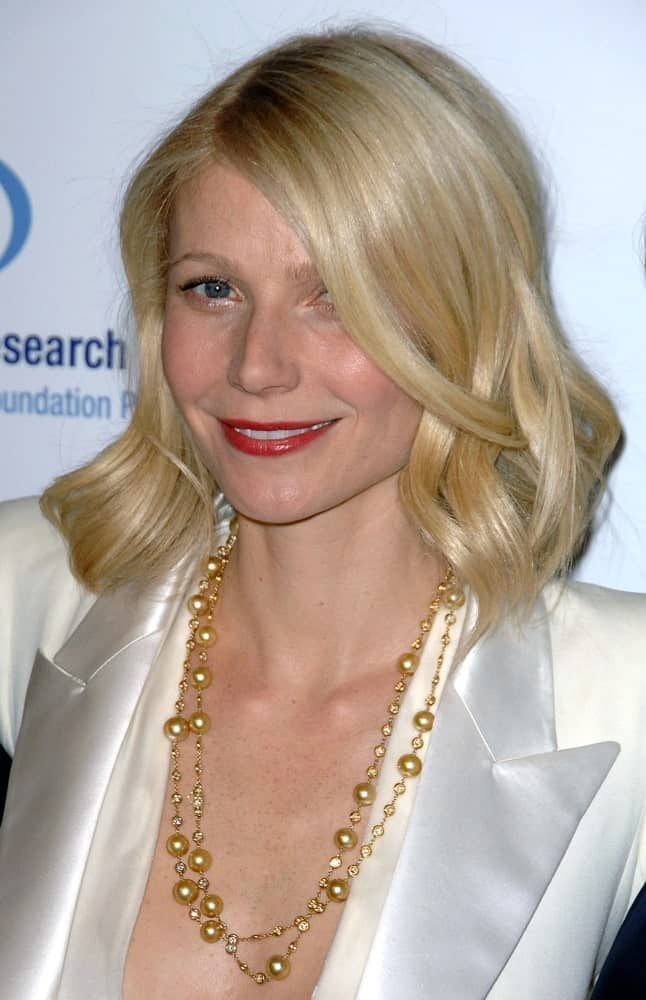 Gwyneth Paltrow overflowed with posh and class in short, stylish curls complemented with a white suit and layered necklace. This look was worn at the Unforgettable Evening Benefiting Entertainment Industry Foundation's Women's Cancer Research Fund on February 10, 2009.