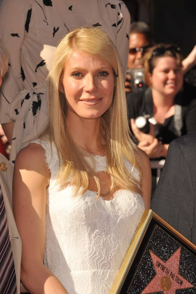 Gwyneth Paltrow looked charming and sweet in a pinned side-swept hairstyle paired with a white textured dress. This was taken at the Hollywood Boulevard where she was honored with the 2,427th star on the Hollywood Walk of Fame held on December 13, 2010.