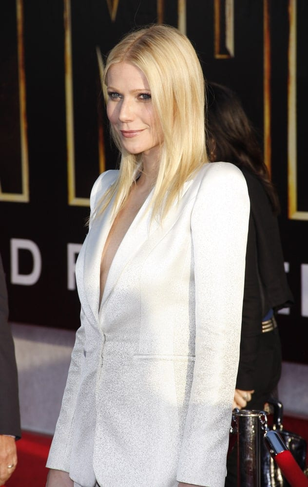 "Gwyneth Paltrow in a sparkling white suit at the World premiere of ""Iron Man 2"" held on April 26, 2010. She had her smooth, silky straight her in loose hairstyle with a middle parting."