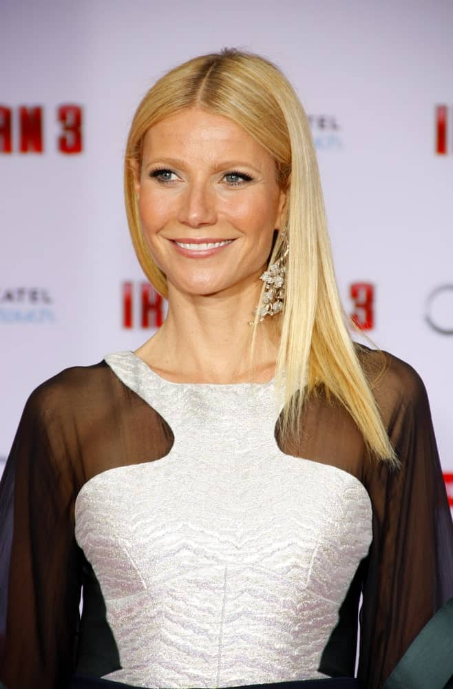 "Gwyneth Paltrow arrived at the Los Angeles premiere of ""Iron Man 3"" held at the El Capitan Theater on April 20, 2013, in an eye-catching dress paired with her straight blonde hair that she gathered on one side."
