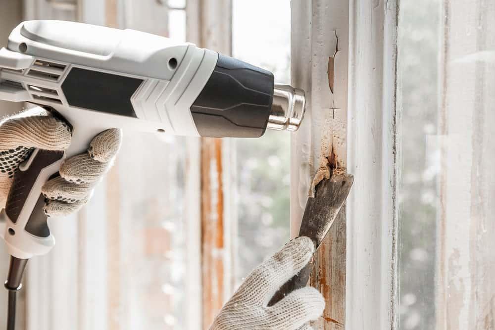 Heat Gun Vs Hair Dryer. A white heat gun being used to melt paint.