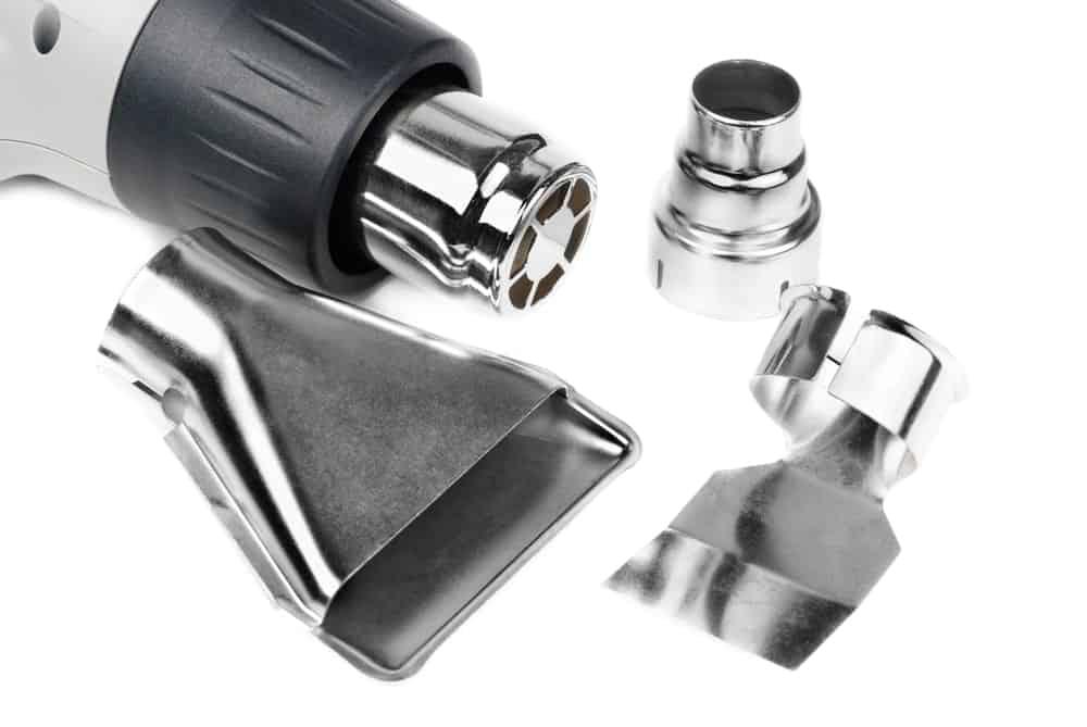 Heat Gun Vs Hair Dryer. A heat gun and its interchangeable nozzles.