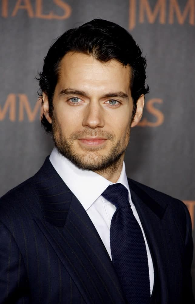 The actor showed off his lustrous black hair paired with a stubble beard at the World premiere of