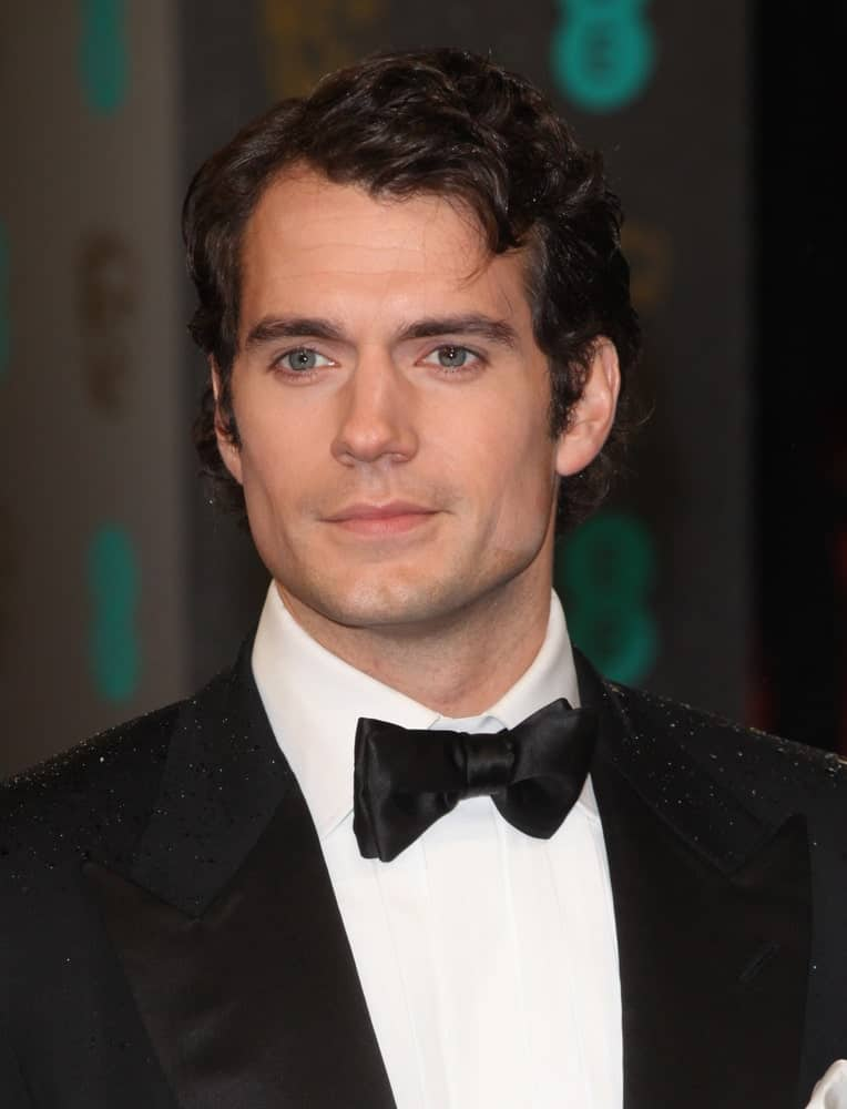 Henry Cavill exhibited his curly black hair with side-parting during the 2013 British Academy Film Awards, at the Royal Opera House, London last October 2nd.