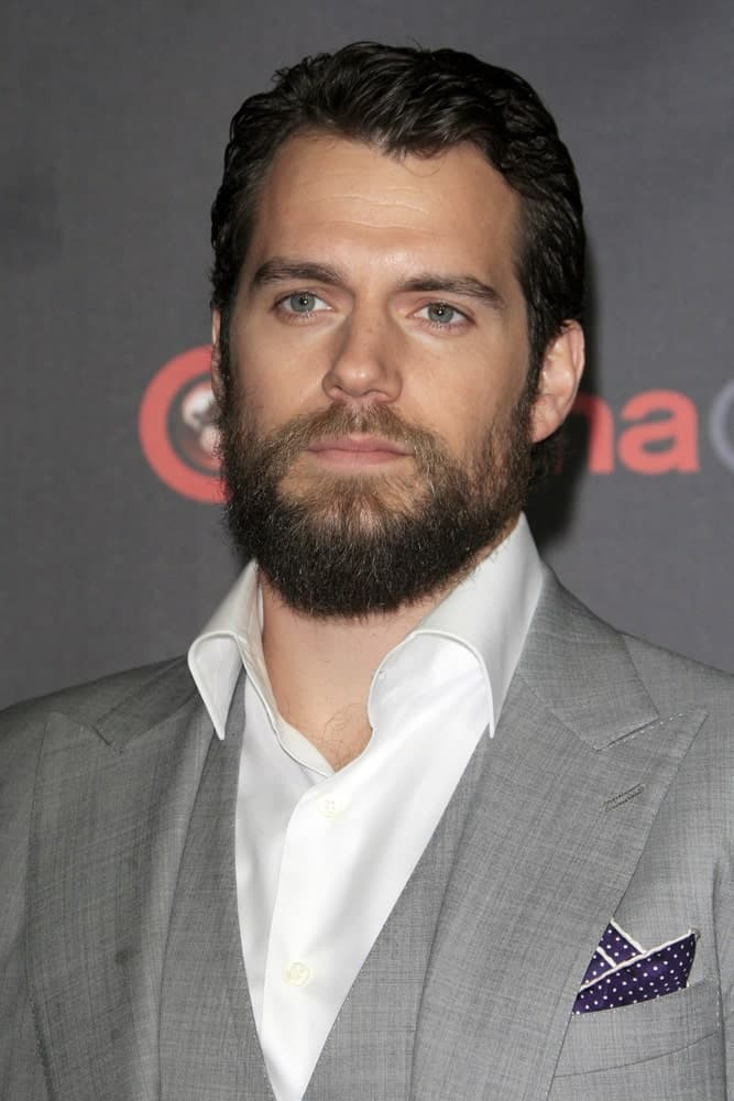 Henry Cavill arrived for the Warner Brothers 2015 Presentation at Cinemacon on April 21, 2015 with short gelled hair and a wild beard.