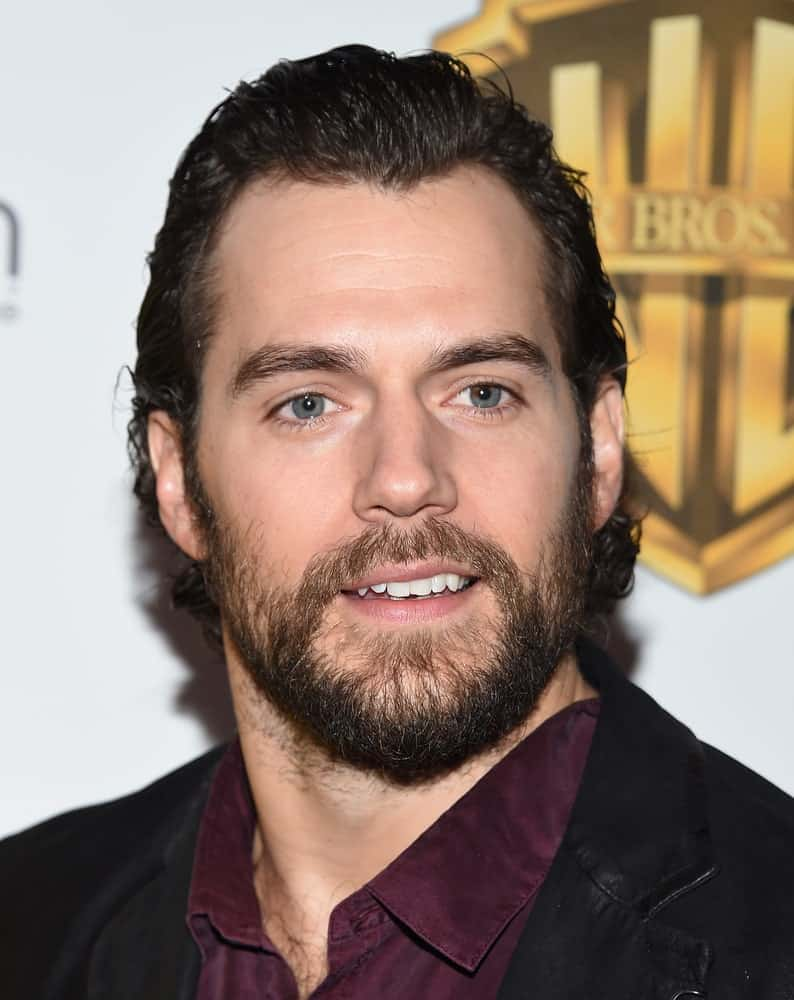 Henry Cavill went with a full beard and longer hair arranged in a gelled sweep back during the CinemaCon 2017-Warner Brothers on March 29, 2017.