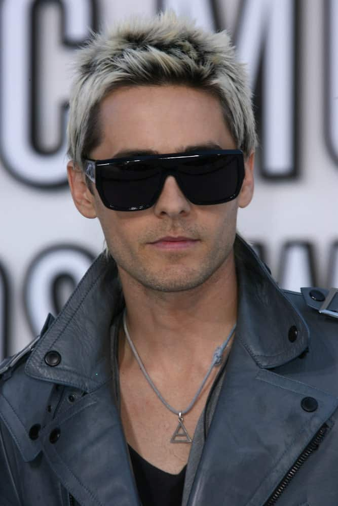 Jared Leto had short spiky hair bleached in platinum blonde with patches of his natural hair color during the 2010 MTV Video Music Awards at Nokia Theatre L.A. LIVE held on August 12th.