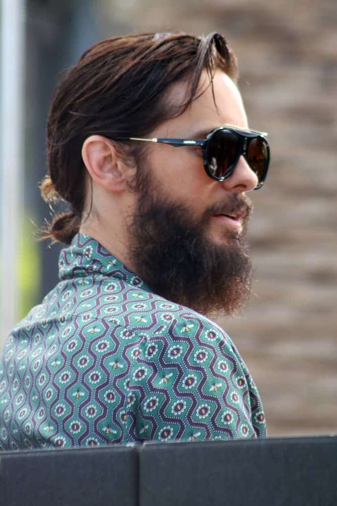 Jared Leto was spotted at Universal City Walk in Hollywood, California on August 23, 2017 rocking a loose man bun incorporated with his natural beard.