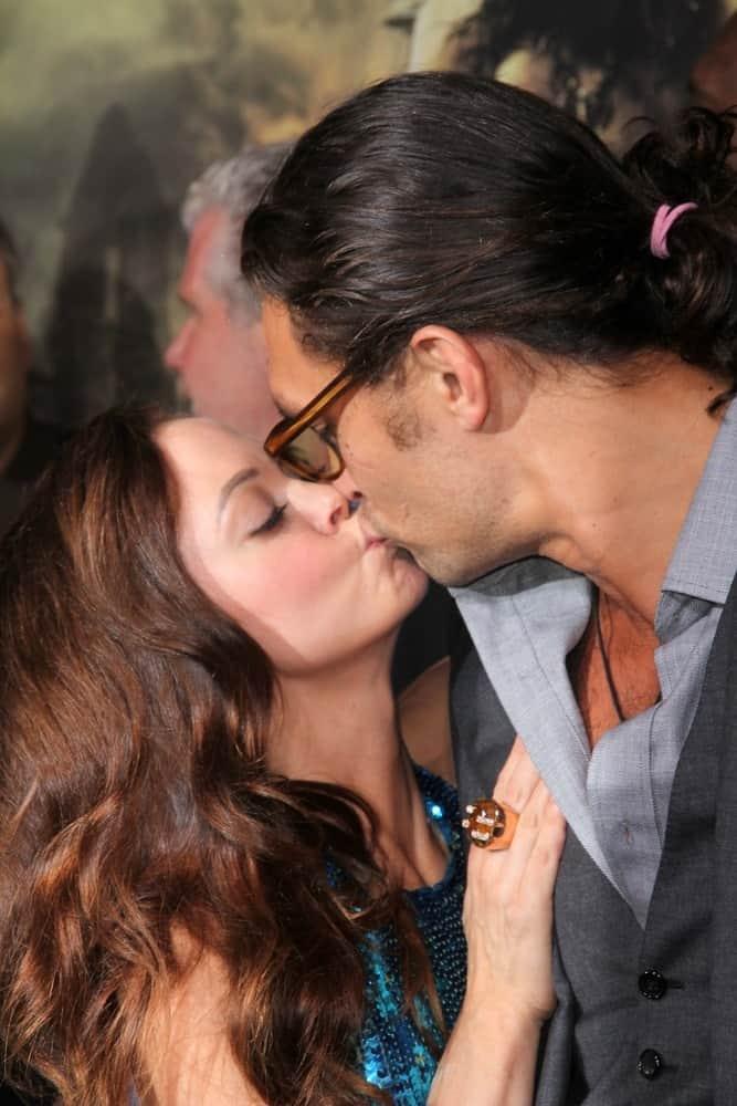Rose McGowan and Jason Momoa kiss at the